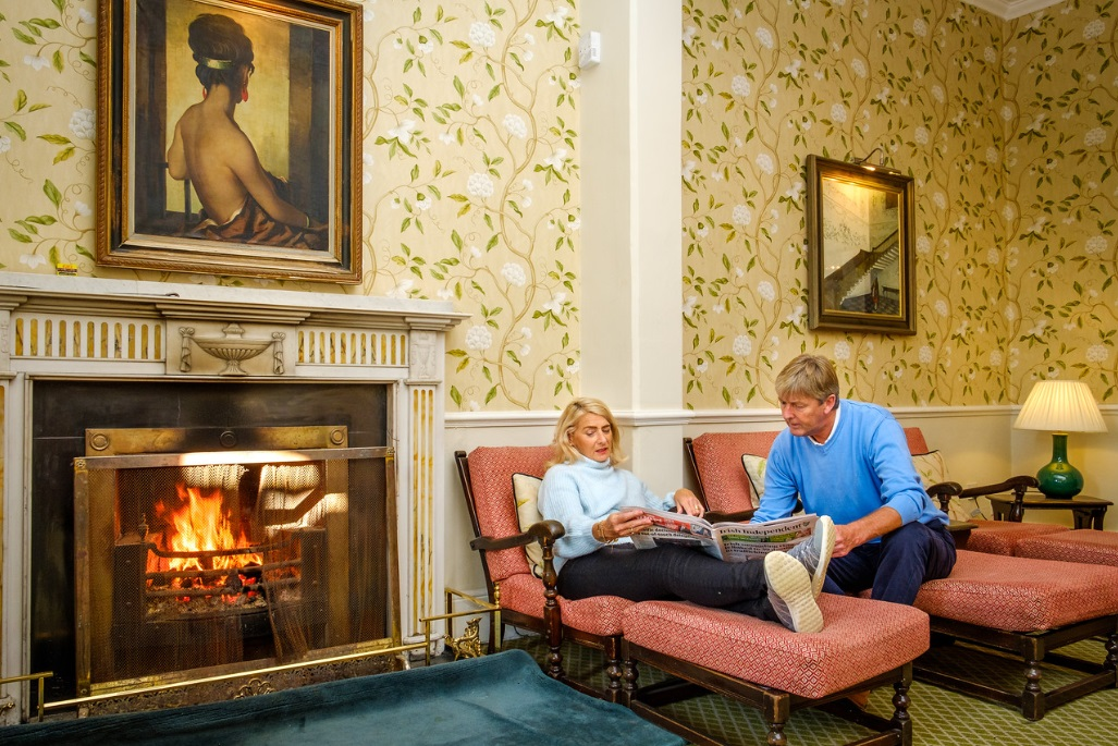 Relax by the fire at Kelly's Resort Hotel & Spa Rosslare